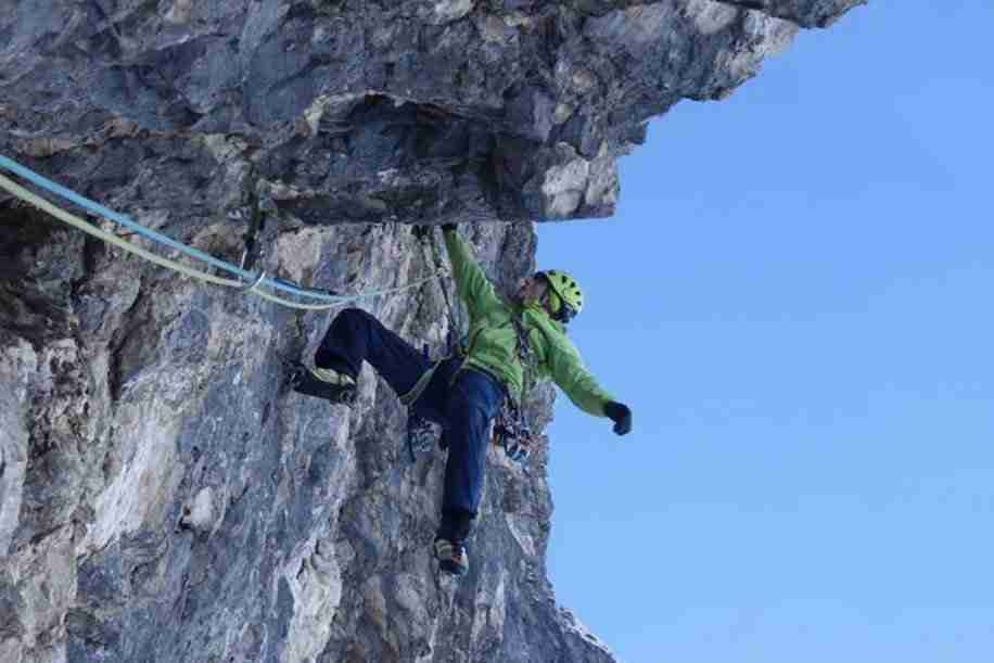 rock climber on mixed route using twin rope setup