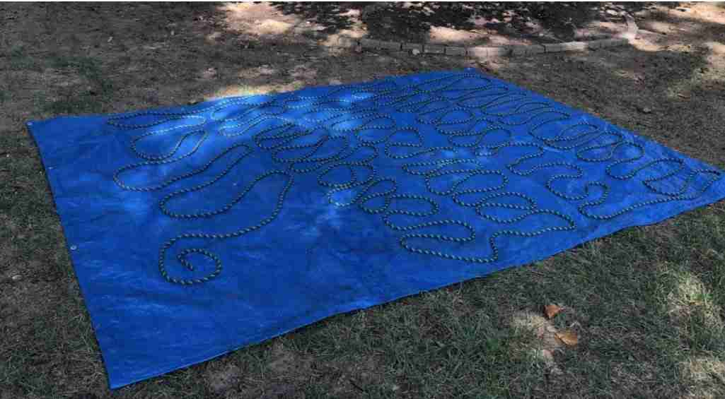 Drying A Climbing Rope On A Tarp After Washing